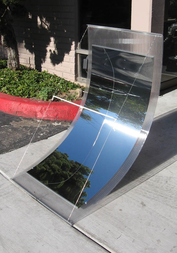 A single 2x4' SolaReflex AA panel bent into a trough parabolic form using twin-wall polycarbonate plastic-click to enlarge